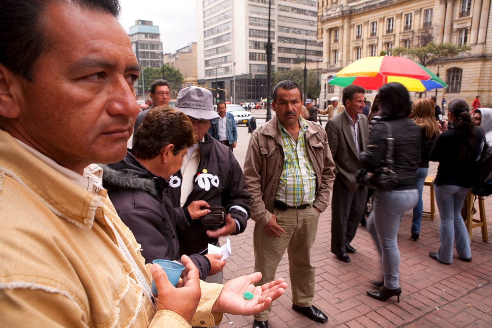 COL_639 Emerald trader keeps a wary eye on Avenida Jimenez, Bogota, Colombia 1000; copyright Christopher P Baker
