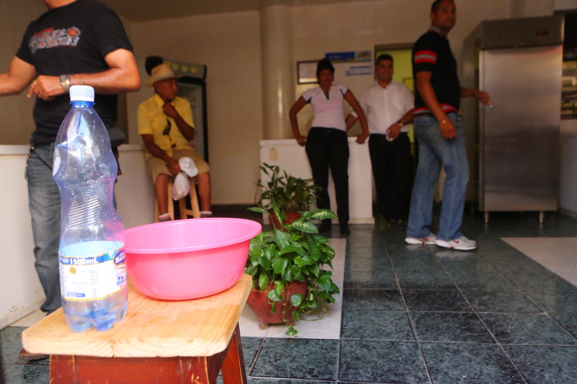 CU SX2A4517 Bottle of bleach at a bank in Bayamo, Cuba; copyright Christopher P Baker