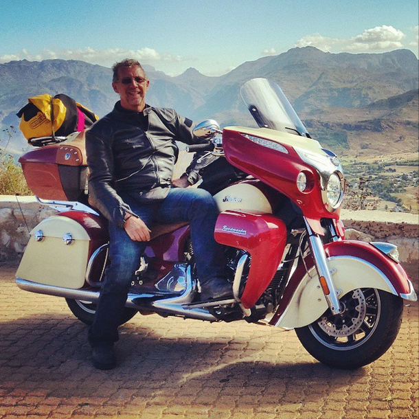 Christopher P Baker and 2015 Indian Roadmaster above Winelands, South Africa; copyright Christopher P Baker