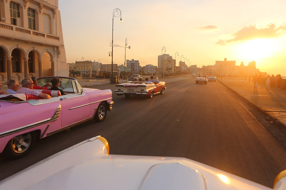 U.S. visitors to Havana riding in classic convertible cars arranged by Christopher P Baker