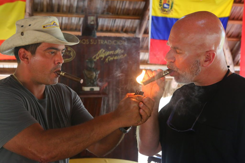 Michael Smerconish and tobacco farmer Hirochi Robaina enjoy a cigar together, Cuba; copyright Christopher P Baker
