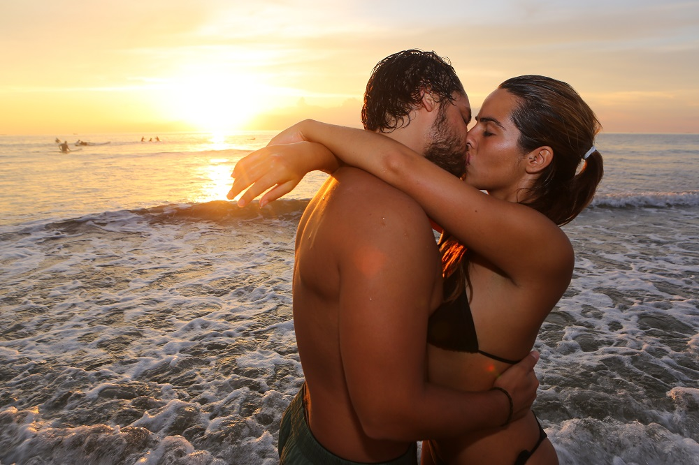 CR SX2A0769 1000px Lovers kiss at sunset on Playa Tamarindo; copyright Christopher P Baker